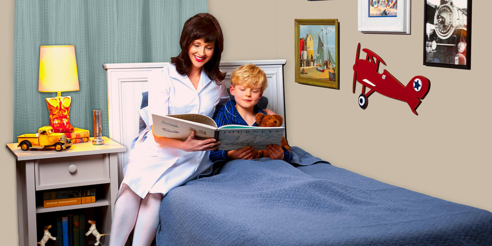nurse on bed reading to boy